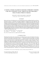 A novel finite element double porosity model for multiphase flow through deformable fractured porous media